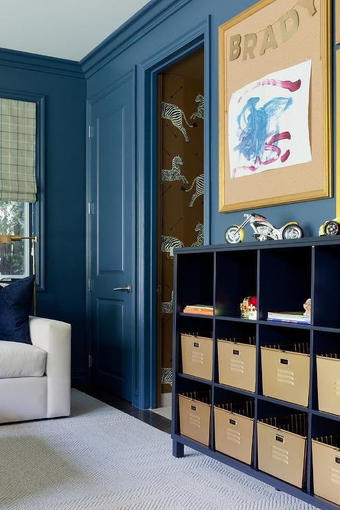 navy blue kid bedroom with navy blue open bookcase transitional