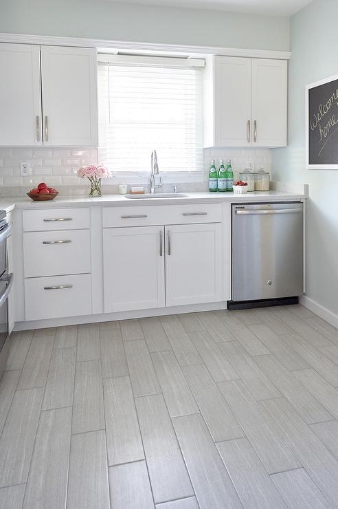Beau White Kitchen With Gray Wood Like Porcelain Floor Tiles