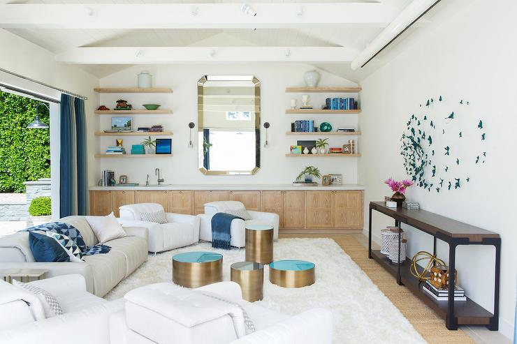 White and blue living room with mirror over wall of low for White mirrors for living room