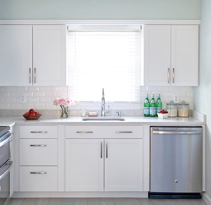 White Arcadia Cabinets With Beveled Subway Tiles