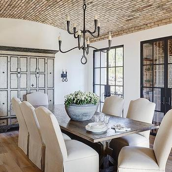 Dining Room With Red Brick Barrel Ceiling