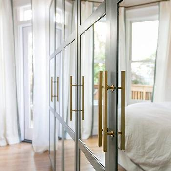 Gray Mirrored Wardrobe Cabinets With Long Brushed Brass Pulls