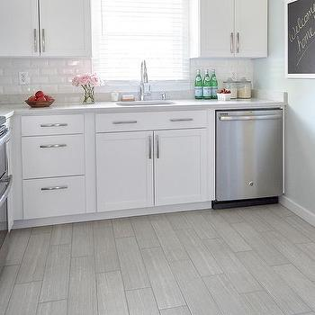 white floor tile kitchen. White Kitchen with Gray Wood like Porcelain Floor Tiles Arcadia Cabinets Beveled Subway