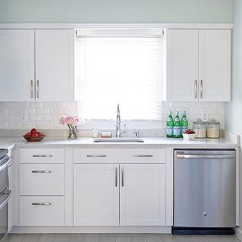 White Arcadia Cabinets With White Beveled Subway Tiles