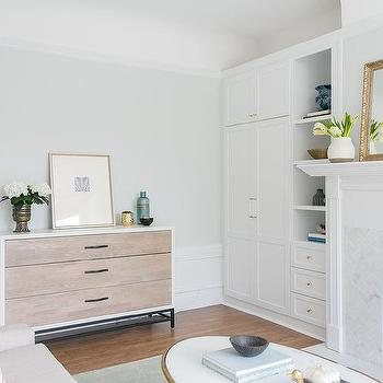 White Living Room Built In Cabinets With Brass And Glass Pulls