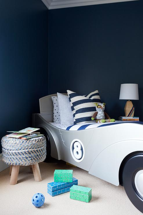 Navy blue boy bedroom with silver race car bed for Car bedroom ideas for boys