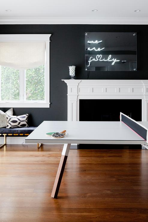 Black And White Game Room With Pink Pong Table In Front Of Fireplace