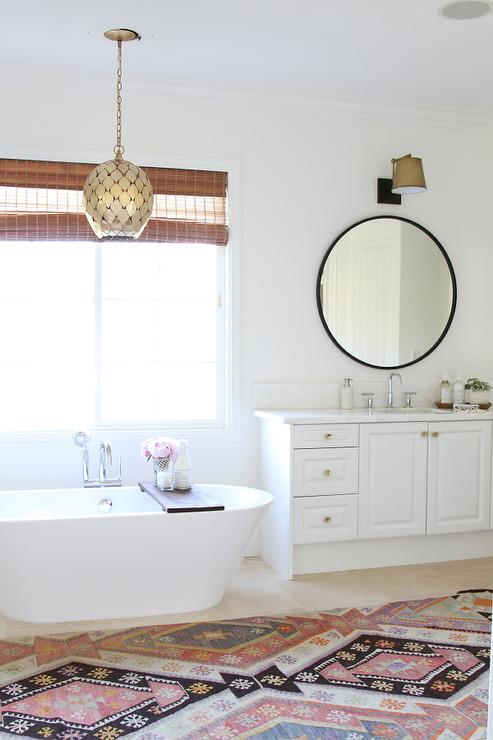 White Vanity With Gold Knobs And Oversized Round Black Mirror