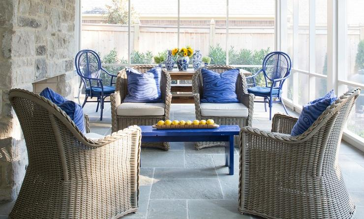 sunroom wicker furniture. Brown And Blue Sunroom With Rustic Stone Fireplace Wicker Furniture