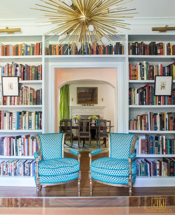 An Eye Catching Brass Sputnik Pendant Hangs Above Two Turquoise Blue  Upholstered French Chairs Placed In Front Of A Doorway Framed By Built In  White ...