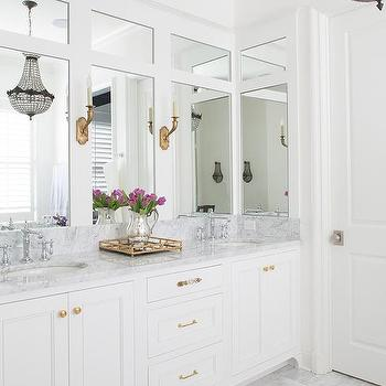 White Dual Bath Vanity with Shiny Gold Hardware and Mirror and Brass Tray. Mirrored Brass Bathroom Tray Design Ideas
