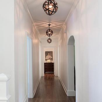 Long Hallway With Geometric Mirrored Cabinets And Hicks