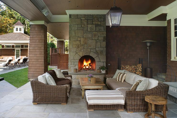 Brown Wicker Sofa And Chairs With Stone Outdoor Fireplace