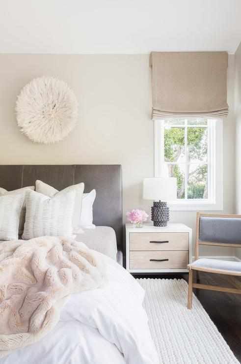 design chic bedroom features a white juju hat placed above a gray
