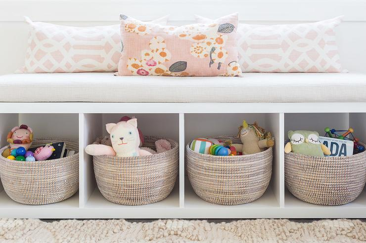 Alyssa Rosenheck Amanda Barnes Interior Design Ethereal S Nursery Features A White Freestanding Storage Bench Filled With Gray Woven Baskets And