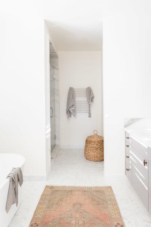 Alyssa Rosenheck: Pink Kilim Bathroom Rug On Marble Herringbone Floors