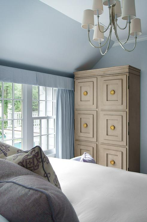 Blue Bedroom with Beige Armoire Cabinet