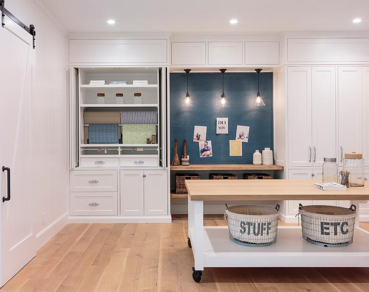 Craft Room With Rolling Butcher Block Island And Blue Grasscloth Pin Board