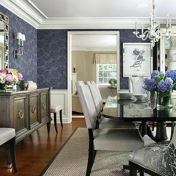 blue and gray dining room with glossy black dining table