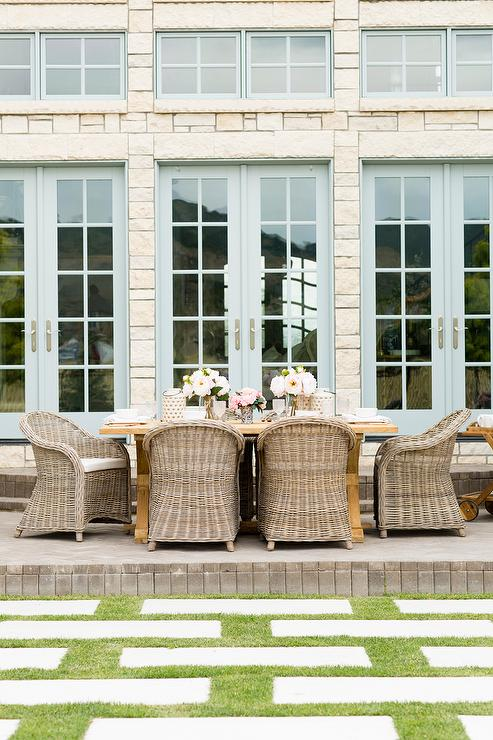 Trestle Outdoor Dining Table With Wicker Dining Chairs