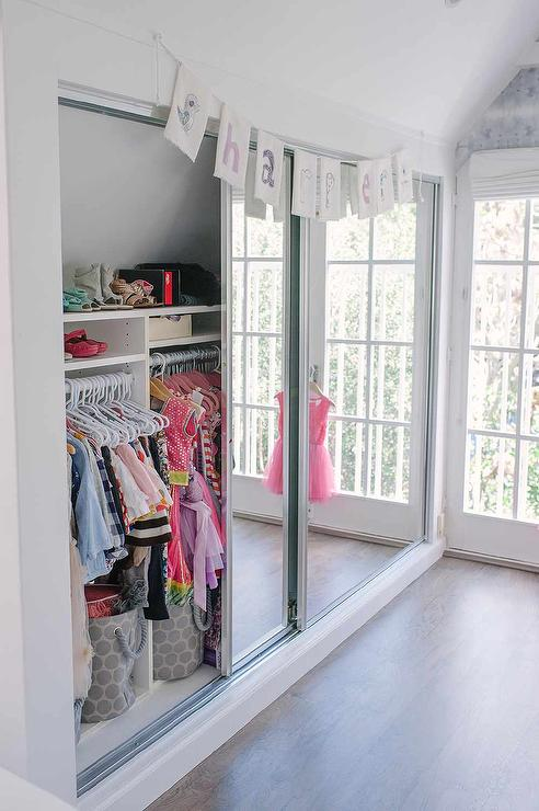 Well Organized Kid Closet With Mirrored Doors