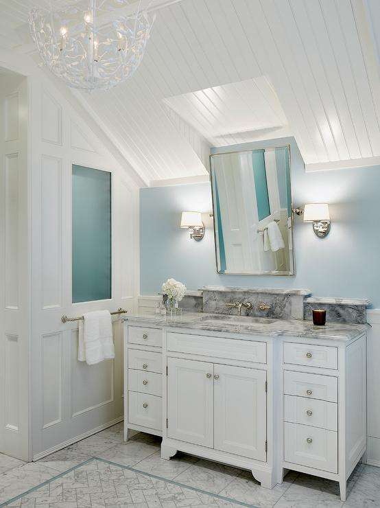Bathroom Ceiling Sconces white and blue bathroom with sloped beadboard trim ceiling