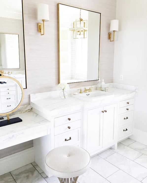 White And Gray Bathroom With Brass Mirror Sconces