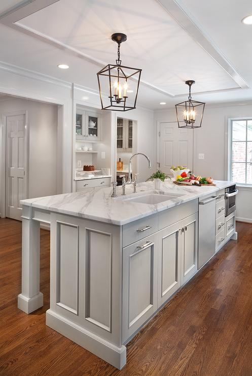 Long light gray center island with sink and dishwasher for Kitchen ideas light grey