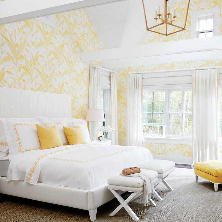 Beautiful White And Yellow Bedroom With Vaulted Ceiling And White X Stools