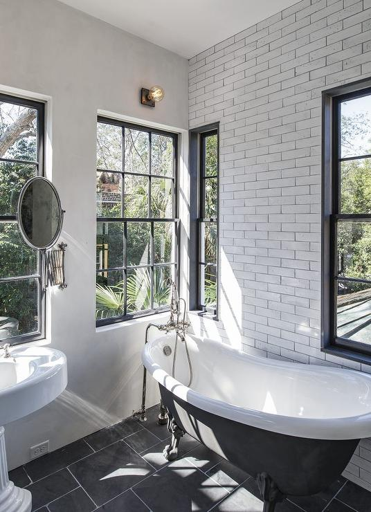Black And White VIntage Bathroom With Black Claw Foot Bathtub View Full Size