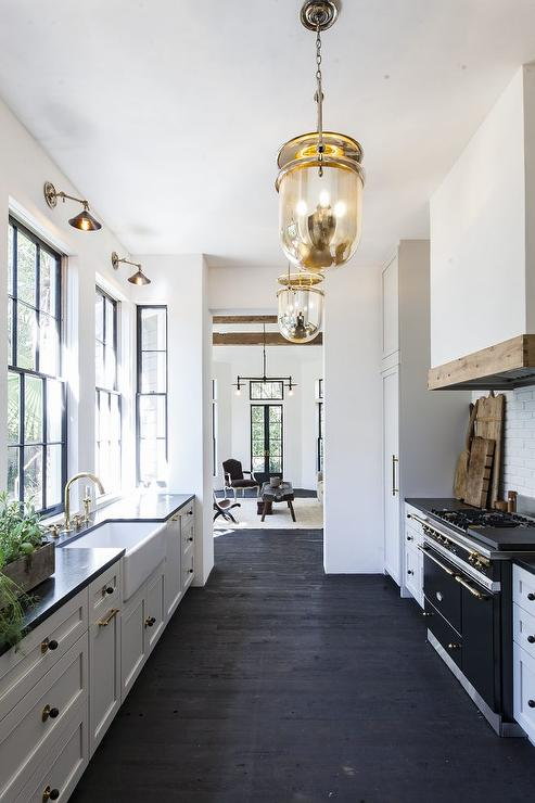 Black And White Galley Style Kitchen With Mercury Glass