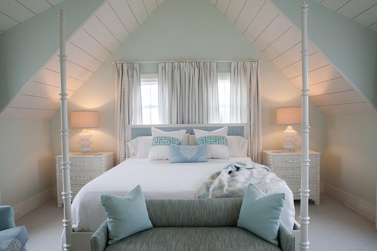 white and blue cottage bedroom with white seashells nightstands