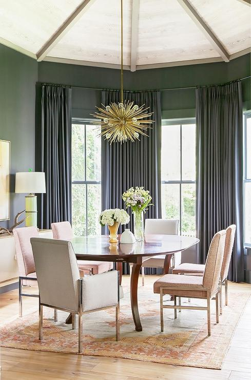 Gray and pink dining room features a vaulted ceiling accented with a brass  sputnik chandelier  Arteriors Zanadoo Pendant  illuminating an oval dining  table. Brass Sputnik Dining Room Chandelier Design Ideas