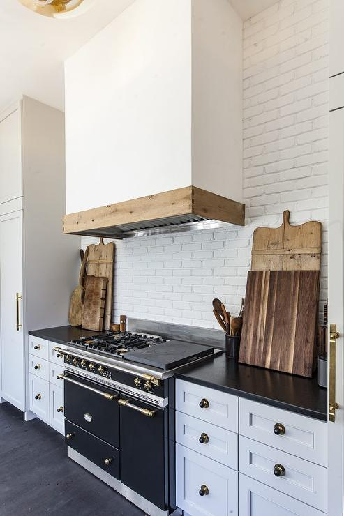 White and black kitchen with exposed white brick wall for White exposed brick wall
