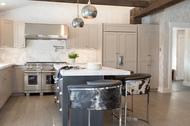 White Kitchen Island With Thick Marble Countertop And Gray