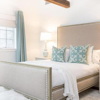 Beige And Blue Cottage Bedroom With Blue French Pleat Curtains