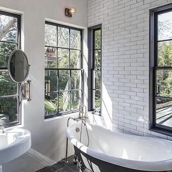 Black and White VIntage Bathroom with Black Claw Foot Bathtub