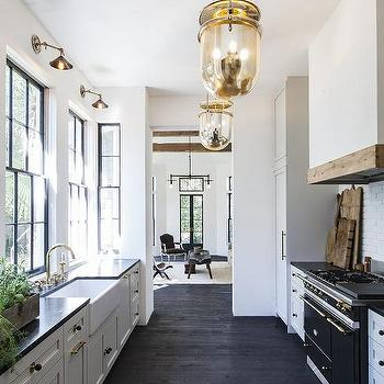 White kitchen cabinets with black and gold hardware for Black and white galley kitchen