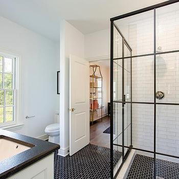 Corner Steel Shower Enclosure with Black Geometric Floor Tiles. Black And White Two Tone Bathroom Design Ideas