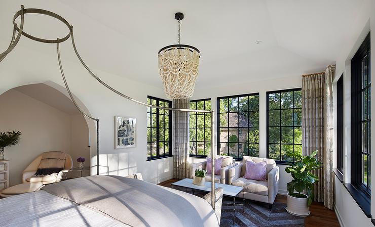 view full size & Iron Canopy Bed with Gray Headboard and Cream Beaded Chandelier ...