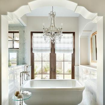 Arched Nook With Freestanding Tub In Front Of French Doors
