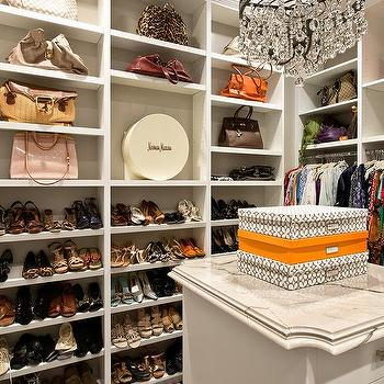 White Walk In Closet With Orange Accents