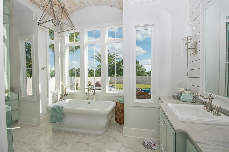 Turquoise Blue Bathroom Features A Turquoise Blue Washstand Adorned With  Lucite Pulls Topped With Gray Marble Fitted With An Overmount White  Porcelain Sink ...
