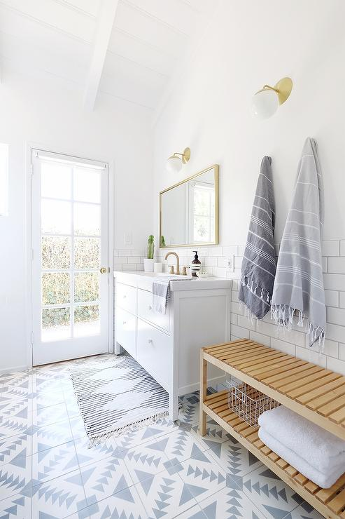 under a vaulted plank ceiling this gorgeous white and gray bathroom features a glass paneled patio door and floors clad in cement tile shop tulum ii tiles