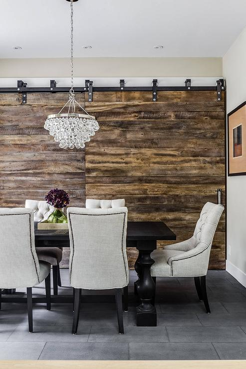 Rustic Dining Room With Rustic Barn Doors On Rails