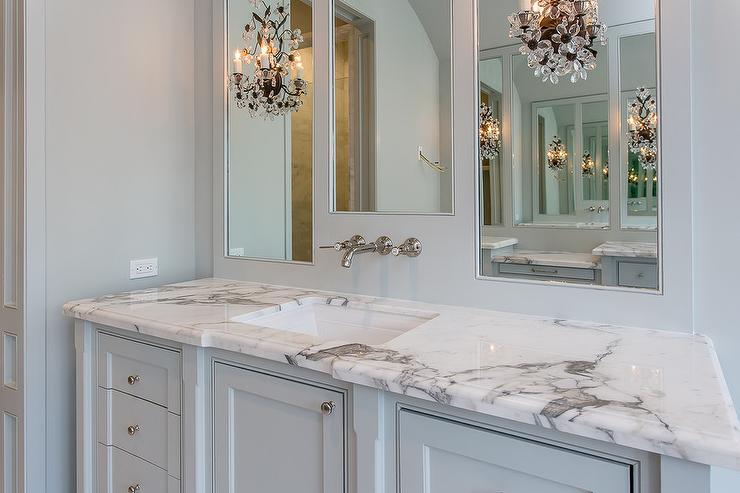 White Bathroom With Greek Key Mirror And Antiqued Mirrored