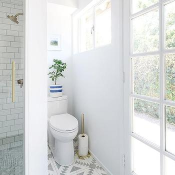 Toilet Nook With CB2 Brushed Brass Toilet Paper Storage Tower