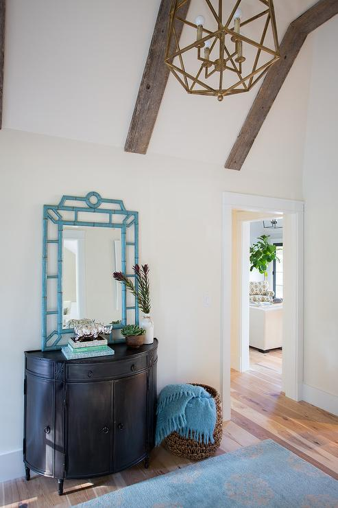 Long foyer with glass moravian star pendants for Half vaulted ceiling with beams