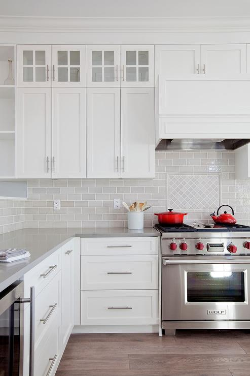 white and gray kitchen with red accents