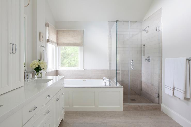 White Bathroom With Taupe Herringbone Floor Tiles